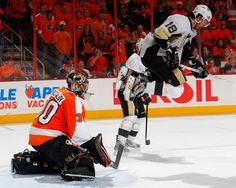 James Neal goes high as Bryzgolav makes a save during Game 6 of the Eastern Conference Quarterfinals Nhl Games, Hockey Games, Hockey Players, List Of All Sports, All About Penguins, Lets Go Pens, Stanley Cup Playoffs, Pittsburgh Penguins Hockey, Sidney Crosby