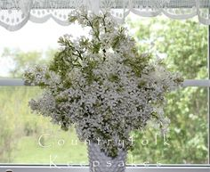 White lilacs in vintage milk glass. <3