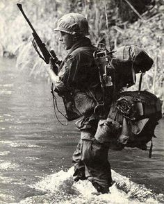 Vietnam War * packed down, and carrying a Winchester model 70.