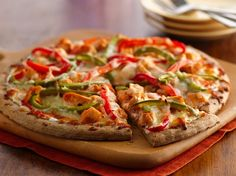 Pizza crust topped with spicy buffalo chicken and bell pepper gives you a cheesy dinner that's ready in 20 minutes.