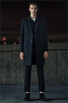 Choose a dark grey overcoat and black chinos for a dapper casual get-up. A cool pair of black suede chelsea boots is an easy way to upgrade your look.   Shop this look on Lookastic: https://lookastic.com/men/looks/overcoat-long-sleeve-shirt-crew-neck-t-shirt/23157   — White Crew-neck T-shirt  — Navy Check Long Sleeve Shirt  — Charcoal Overcoat  — Black Chinos  — White Socks  — Black Suede Chelsea Boots