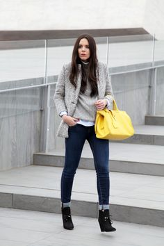 Grey layers, blue denim, black boots and a yellow tote
