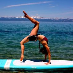 SUP yoga. Trying this at the end of the summer-or as soon as my yoga practice is back up to where I left off before pregnancy-with Erin! Visit my website for more details. Paddle Board Yoga, Sup Stand Up Paddle, Sup Paddle, Pilates, Sup Yoga, Yoga Posen, Challenge, Yoga Photography, Gymnastics Photography