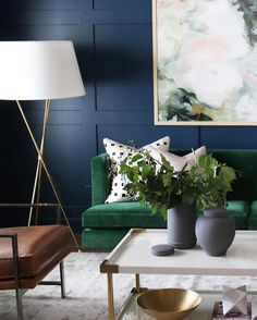 Green sofa contrasted by navy walls...beautiful! Instagram photo by @studiomcgee