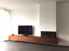 Three-sided Stuv (Rca) B-Fire 95 with the moving American-style Walnut TV cabinet Hooijer Appliances, and Flooringamerican Home Fireplace, Living Room With Fireplace, Fireplace Surrounds, Fireplace Design, Living Room Tv, Living Room Modern, Style At Home, Contemporary Cabin, Happy New Home