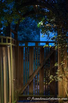 Downlight the path under an arbor | 8 Landscape Lighting Effects And How To Use Them | Whether you're looking for DIY landscape lighting ideas for your front yard, backyard or walkway, this list will help! It shows you lots of ways to use both low voltage and solar lights in your garden or patio.
