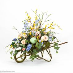 Spring arrangement in moss wheelbarrow- would like to see something like this for a gardener