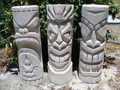 These stone Tikis would look great beside a Tiki bar.
