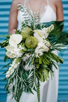Blue Wedding Flowers tropical green and white bouquet with lilies and proteas - Capturing Oahu's fine balance between island paradise and concrete jungle, this modern Hawaiian shoot is everything we love to see in a tropical wedding. Tropical Wedding Bouquets, White Wedding Flowers, Bridal Flowers, Green Wedding, Floral Wedding, Trendy Wedding, Flowers Wine, Tropical Weddings, White Bridal