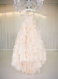 Glamorous and romantic blush pink ruffled wedding dress - so perfect for a black tie wedding monique lhullier