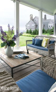 My idea of a beautiful covered porch...cape code, wicker, pillows, ocean...perfection.