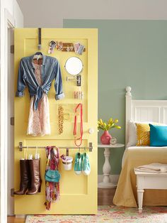 If you share a room or could use some extra prep space, use hardware-store add-ons to maximize storage. Attaching hooks, bars, containers, and a mirror to the back of this door created a handy hang-up spot for next-day outfits and accessories.