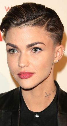 21 Gorgeous Super Short Hairstyles: #11. Ruby Rose Super short hair with clipper designs