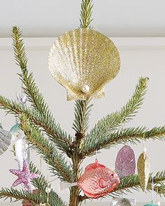 Top a seaside-inspired Christmas tree with a large, glittering shell for a magnificent effect.