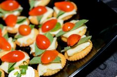 Cheese/basil/cherry tomatoes on crackers