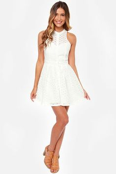 The Eyelets Have It Ivory Lace Dress: Adorable and flattering, its no wonder that this dress is such a big hit. Woven cotton fabric flaunts eyelet lace throughout, starting at a high-neck bodice with sheer decolletage, down a banded waist, and pleated full skirt. Button-up front and sheer back panel add the kind of detail youll instantly love. Bodice is partially lined. Skirt is lined. Hand wash cold $55