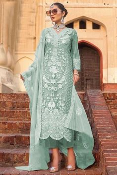 Cast a spell with this Dusty Green Net Trouser Suit Which will surely tell them that the diamonds aren't the only beautiful thing which they have seen. This V neck and Quarter Sleeves Party Wear Attire highlighted with stone, sequins and dori work.  Along with Santoon Trouser in Dusty Green Color with Dusty Green Net Dupatta. Dupatta highlighted with Stone, Sequins and Dori Work.  This Trouser Suit can be customised up to 44 Inches around the Bust.
