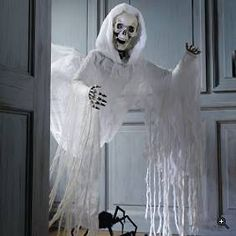 Ghostly visitor-DIY? use dollar store skeleton, cheap white fabric and hang with fishing line