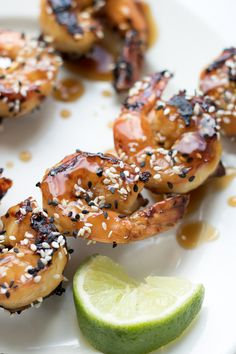 This Grilled Teriyaki Sesame Shrimp uses fresh jumbo shrimp and a homemade teriyaki sauce. It's perfect as an appetizer for outdoor entertaining or on its own over rice as a weeknight meal. This shrimp on a stick is finger-licking good!
