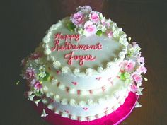 Pink floral Retirement Cake photo.jpg