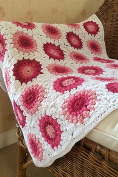 I worked the first three rounds of the sunburst pattern to produce a pile of brightly coloured circles and then crocheted them all together at the end using a continuous join. (http://bab...