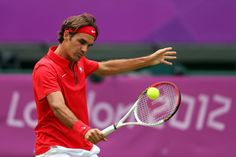 Roger Federer of Switzerland returns a shot against Alejandro Falla of Colombia during their Men's Singles Tennis match on Day 1 of the London 2012 Olympic Games at the All England Lawn Tennis and Croquet Club in Wimbledon on July 28, 2012 in London, England. (Photo by Clive Brunskill/Getty Images)