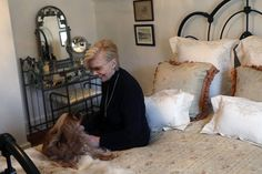 Kathleen Wolf and her dog Cooper in the bedroom of her new home in rural...