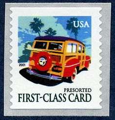 This postcard rate stamp features a woody station wagon, popular with American families on vacation during the middle of the 20th century.
