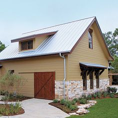 - all-metal roof (I like this metal roof – style and light reflective color)  - sliding door for shed bay  - shed dormer