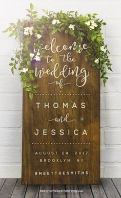 Rustic wood wedding sign says welcome to the wedding in modern elegant font. They will customize it with your names, date, and wedding hashtag. There's a link to it on the page.