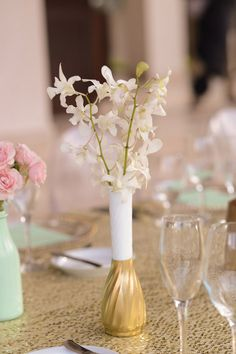 gold-dipped milk glass, photo by Katherine Stinnett http://ruffledblog.com/guanacaste-destination-wedding #centerpieces #gold #milkglass