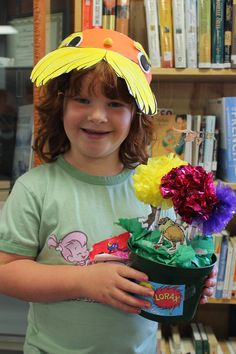 Ages 6-8. Their Lorax Hat and Their Truffula Tree Forest.