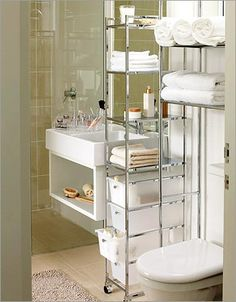 Small Bathroom: love the narrow shelf tower between the sink & toilet. good use of space! #storage #organize