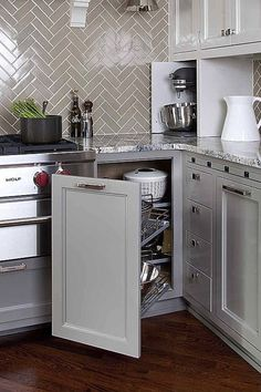 Gray cabinets & gray herringbone backsplash | pull-out appliance drawer