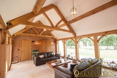 Beautiful oak framed sun room with bespoke oak trusses.