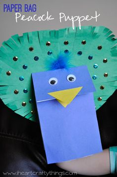 Paper Bag Peacock Puppet Craft for kids www.iheartcraftythings.com #EarlyLearnersAcademy #preschoolcrafts