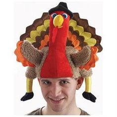GOBBLE THANKSGIVING TURKEY HAT FUNNY NOVELTY (00721773655371) These Thanksgiving turkey costume accessory hats are a blast! Unless you are Joey from Friends, how often do you really get to put a turkey on your head? These hats are stuffed-plush, made of a felt-polyester, feature a full turkey with wings, legs, huge tail-end and pilgrim hat, are 1-size fits all, ready to rock your party! Great on their own, even better with the other colonial and pilgrim themed accessories in our store!