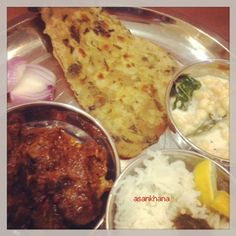 Indian thali hot and spicy meat curry,drumstick leaves paratha,boondi raita and rice