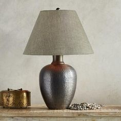 GRAY'S RIVER TABLE LAMP - Rustic and refined, a hammered iron lamp with a stunning patina and sophisticated cotton shade.