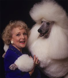 Betty White with her white standard poodle.