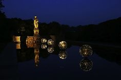 Illuminated Floating Orbs Create a Dazzling Garden Display - My Modern Metropolis