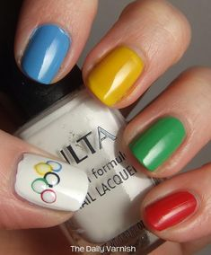 Some ways to show your Olympic spirit! Saw the girls from the USA shooting team sporting some cute nails for the games.