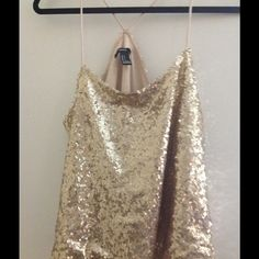Forever21 Gold Sequin Cami Top Never worn without tags gold sequin top. Purchased from Forever21 store. Can fit a small or medium. Excellent condition. Forever 21 Tops Camisoles