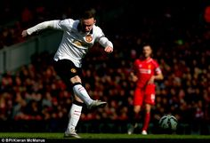 Manchester United captain Wayne Rooney shoots for goal at Anfield