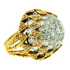 1960s Diamond Bombe Cocktail Ring  18k textured gold cocktail ring designed as a basket setting of diamond-shaped elements surrounding approximately five carats of diamonds