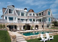 the beautiful backyard of a cape cod home