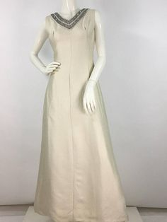 Elegant, beautifully tailored, embellished detail, very classy vintage evening gown mannequin measures 5ft 8, bust 34, waist Measurements: length 56.5/waist 14/bust 16  Please note that vintage clothing sizes can vary greatly. The Measurements provided are approximate and are taken lying
