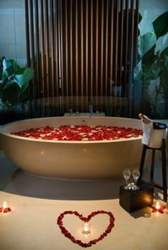36 Romantic Bathroom Ideas  Love the red rose petals and the champagne