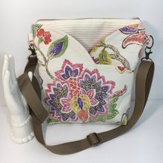 ~~~~~~~~~~~~~~ This one is Stunning!!~~~~~~~~~~  Our Newest design carried out in a beautiful winter white and luscious floral print in a heavy weight linen type fabric. The floral and heavy nub texture of this fabric is delightful to look at and reminds me of a crisp snowy day. Ive added an appliqued floral design to one side of this bag taken from the linen floral fabric.   This bag is a perfect combination of stunning fantasy floral fabric and nubby textured Ralph Lauren upholstery weight…