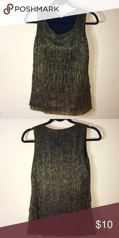Dress Barn gold metallic top This is a gold metallic color. Never worn. Made of 52% metallic, 48% polyester. Dress Barn Tops Blouses